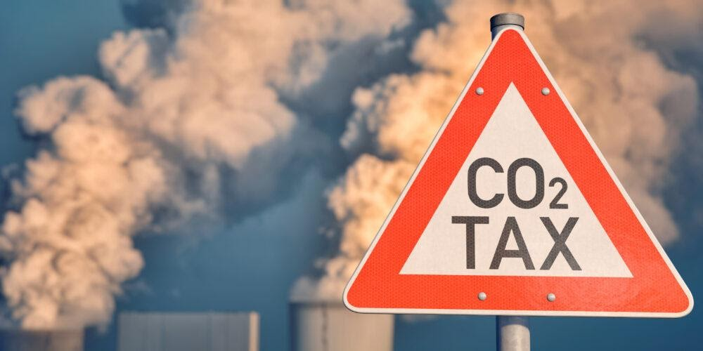 the-benefits-of-a-carbon-tax-pricing-the-carbon-content-of-domestic-production-and-imports-will-help-cut-effluents-th